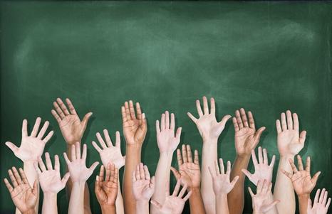 Multiethnic Group of Hands Raised with Blackboard